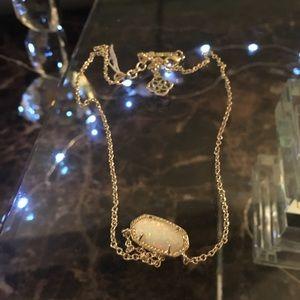 Kendra Scott.  Elisa gold in white Kyocera opal.
